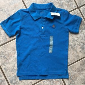 Polo with tag